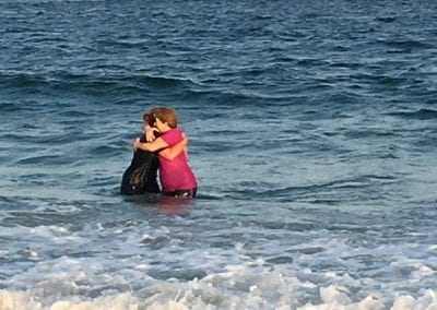 Libby baptizing a friend at Wrightsville Beach